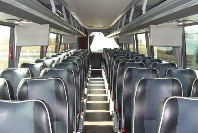 Leather seating with high-backs in Motorcoach