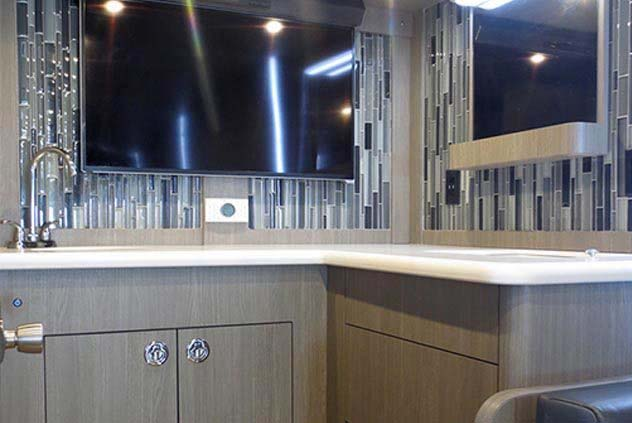 VIP Motorcoach Flat Screen Television with Sink and Countertop